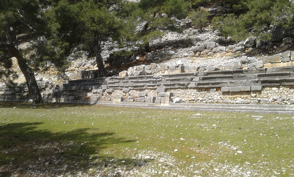 Only a few rows of stone seats in the half stadium
